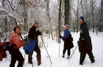four cross-country skiers